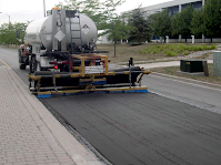 Geotextile paving fabric